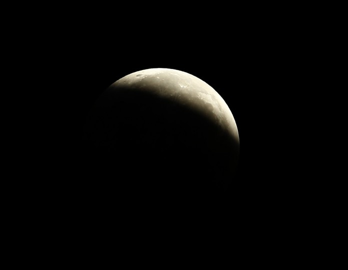 "The moon is pictured moments after a total lunar eclipse, from Encinitas, California October 8, 2014. The eclipse is also known as a ""blood moon"" due to the coppery, reddish color the moon takes as it passes into Earth's shadow. The total eclipse is the second of four over a two-year period that began April 15 and concludes on Sept. 28, 2015. The so-called tetrad is unusual because the full eclipses are visible in all or parts of the United States, according to retired NASA astrophysicist Fred Espenak. (Mike Blake/Reuters)"