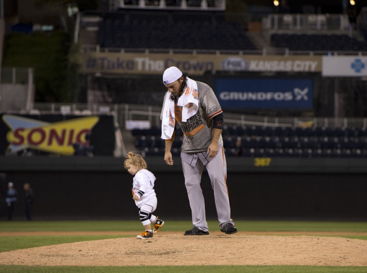 The San Francisco Giants' Brandon Crawford chases his daughter, Braylyn, off of mound following the celebration in Game 7 of the World Series on Wednesday, Oct. 29, 2014, at Kauffman Stadium in Kansas City, Mo. The Giants defeated the the Kansas City Royals, 3-2, to capture the Series title. (Jose Luis Villegas/Sacramento Bee/MCT)