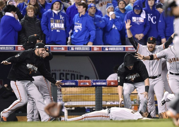 San Francisco Giants third baseman Pablo Sandoval celebrates on the ground after catching the final out, off the bat of the Kansas City Royals' Salvador Perez, in Game 7 of the World Series on Wednesday, Oct. 29, 2014, at Kauffman Stadium in Kansas City, Mo. The Giants won, 3-2, to capture the Series title. (John Sleezer/Kansas City Star/MCT)