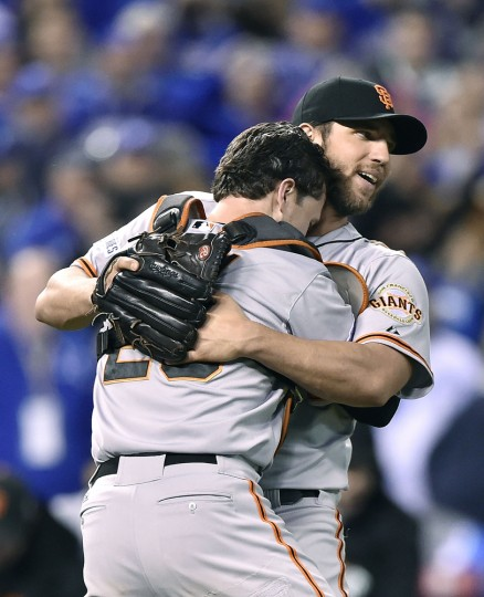 San Francisco Giants pitcher Madison Bumgarner, right, celebrates with catcher Buster Posey after winning, 3-2, in Game 7 of the World Series against the Kansas City Royals on Wednesday, Oct. 29, 2014, at Kauffman Stadium in Kansas City, Mo. (David Eulitt/Kansas City Star/MCT)
