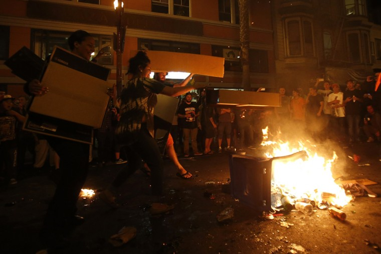 Revellers add fuel to a street bonfire in celebration in San Francisco, California October 29, 2014. The San Francisco Giants beat the Kansas City Royals 3-2 on Wednesday to win their third World Series title in five seasons. (Stephen Lam/Reuters)