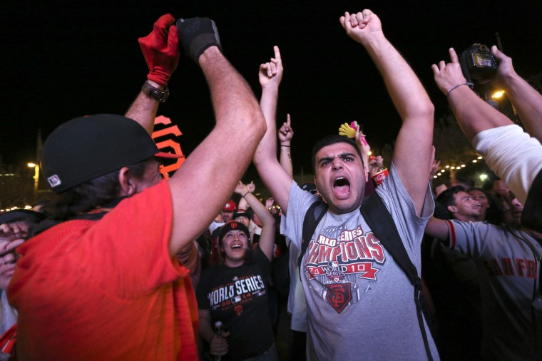 Fan Elior Ilishah celebrates during the San Francisco Giants win over the Kansas City Royals in the World Series during a television viewing event at the Civic Center in San Francisco, California October 29, 2014. (Robert Galbraith/Reuters)