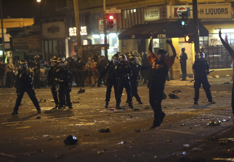 Police begin to disperse a crowd gathered in the Mission District in San Francisco, California October 29, 2014. The San Francisco Giants beat the Kansas City Royals 3-2 on Wednesday to win their third World Series title in five seasons. (Robert Galbraith/Reuters)