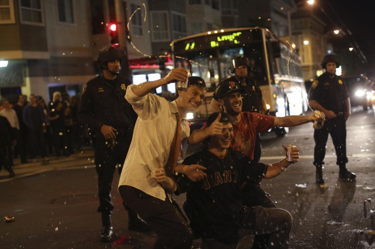 Fans celebrate in the street in the Mission District after the San Francisco Giants defeated the Kansas City Royals in Game 7 of the World Series, in San Francisco, California October 29, 2014. The San Francisco Giants beat the Kansas City Royals 3-2 on Wednesday to win their third World Series title in five seasons. (Robert Galbraith/Reuters)