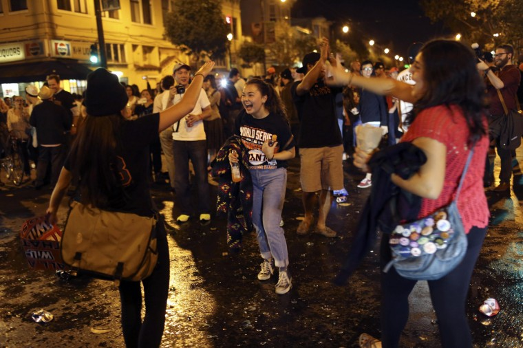 Fans celebrate on a street in the Mission District after the San Francisco Giants defeated the Kansas City Royals in Game 7 of the World Series, in San Francisco, California October 29, 2014. The San Francisco Giants beat the Kansas City Royals 3-2 on Wednesday to win their third World Series title in five seasons. (Robert Galbraith/Reuters)
