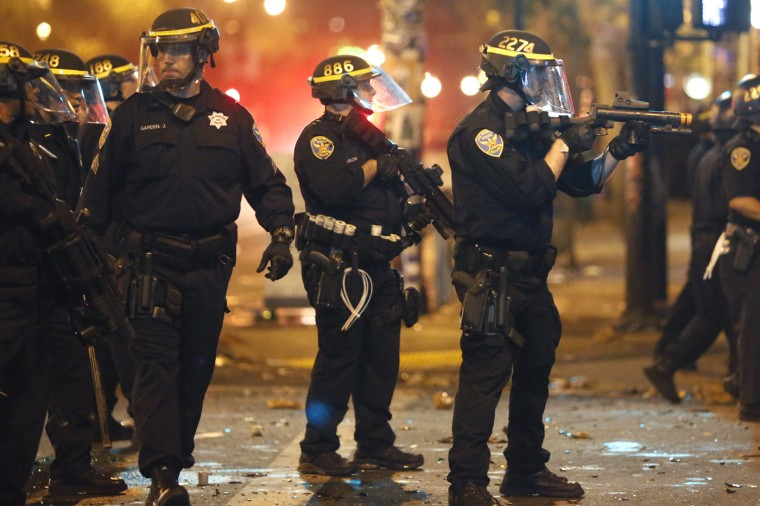 Police officers try to disperse a crowd in San Francisco, California October 29, 2014. The San Francisco Giants beat the Kansas City Royals 3-2 on Wednesday to win their third World Series title in five seasons. (Stephen Lam/Reuters)