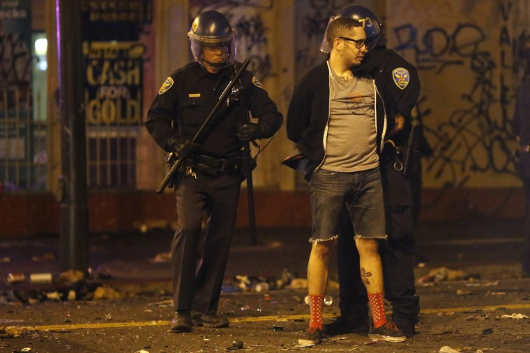 A man is being detained by the police after a street celebration in San Francisco, California October 29, 2014. The San Francisco Giants beat the Kansas City Royals 3-2 on Wednesday to win their third World Series title in five seasons. (Stephen Lam/Reuters)
