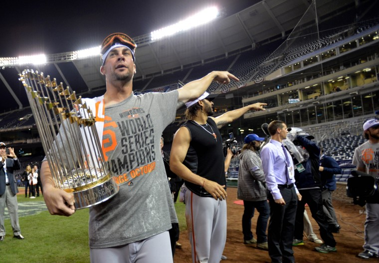San Francisco Giants starting pitcher Ryan Vogelsong holds the Commissioners Trophy after game seven of the 2014 World Series against the Kansas City Royals at Kauffman Stadium. (Peter G. Aiken-USA TODAY Sports)