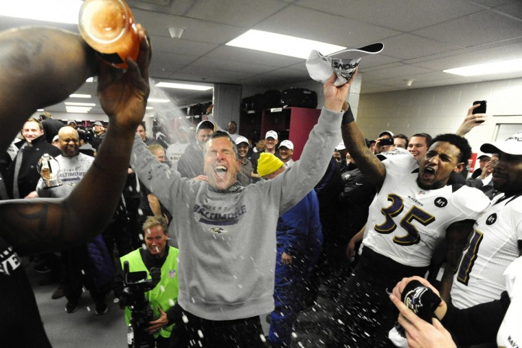 Ravens coach John Harbaugh gets sprayed with champagne after Baltimore won the AFC Championship in January of 2013. (Kenneth K. Lam/Baltimore Sun)
