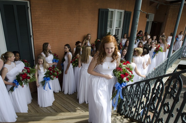 Mount de Sales Academy held its class of 2014 graduation Saturday May 24, 2014. The graduates wore white dresses and held bouquets of red roses. (Nicole Martyn/File photo)