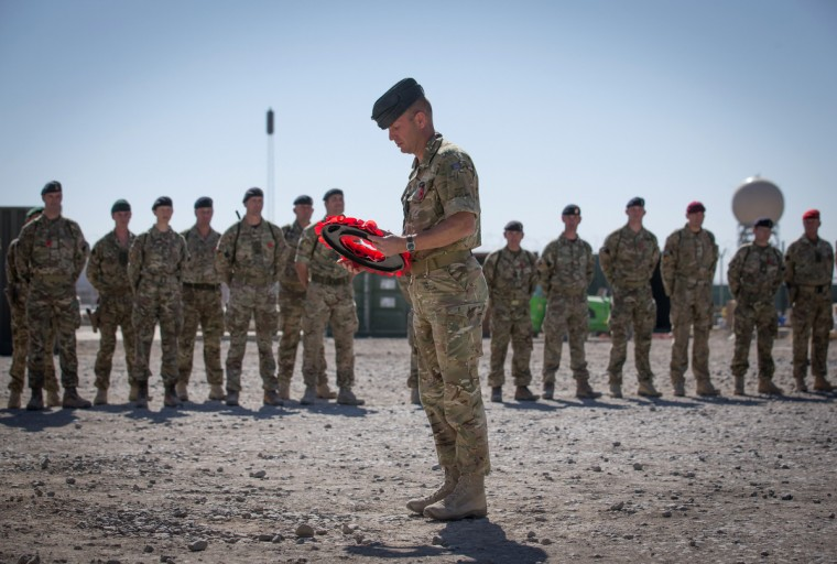 Brigadier Rob Thomson lays a wreath during a ceremony to mark Armistice Day attended by some of the British troops that still remain in Afghanistan at Kandahar airfield on November 11, 2014 in Kandahar, Afghanistan. (Matt Cardy/Getty Images)