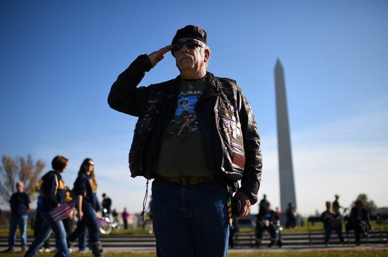 Vietnam war veteran Joe 'Dragon' Lozano, retired U.S. Army, salutes during the playing of ÒTapsÓ at a Veterans Day ceremony at the World War Two Memorial November 11, 2014 in Washington, DC. Originally established as Armistice Day in 1919, the holiday was renamed Veterans Day in 1954 by President Dwight Eisenhower, and honors those who have served in the U.S. military. (Win McNamee/Getty Images)