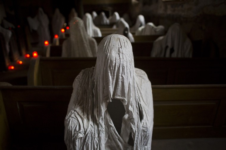 Ghost statues by artist Jakub Hadrava are placed at the St. George's church near Plzen in Lukova, Czech Republic. Artist Jakub Hadrava created 32 plaster life-size ghost statues, which symbolize Sudeten Germans who lived in the village. St. George's church, which was build in the north-western Bohemian region of the Czech Republic in 1352, fell into disrepair after the roof collapsed during a funeral service in 1968. Hadrava's aim is to make the church more attractive for visitors and to gain money for renovation work. According to voluntary church manager Petr Koukl, about 2500 people from around the world have been visiting the church this year. (Matej Divizna/Getty Images)