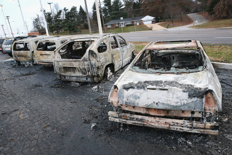 Cars which were set on fire when rioting erupted following the grand jury announcement in the Michael Brown case sit on a lot on November 25, 2014 in Dellword Missouri. Brown, an 18-year-old black man, was killed by Darren Wilson, a white Ferguson police officer, on August 9. At least 12 buildings were torched and more than 50 people were arrested during the night-long rioting. (Photo by Scott Olson/Getty Images)