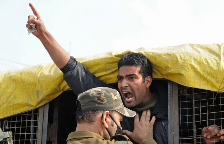 Indian police personnel detain a Kashmiri Shiite Muslim during clashes with Kashmiri protestors defying restrictions for a Muharram procession in Srinagar. Authorities imposed restrictions in parts of Srinagar, the summer capital of Kashmir,to thwart planned Muharram processions as police detained more than a dozen protesters and fired teargas to disperse participants. (Rouf Bhat/Getty Images)