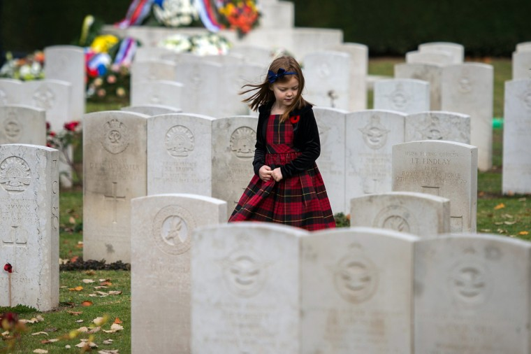 A young girl walks past tombstones after an Armistice Day ceremony at the Belgrade War cemetery in Belgrade on November 11, 2014, as part of Armistice Day ceremonies marking the 96th anniversary of the end of World War I. (AndreJ Sakovic/AFP/Getty Images)