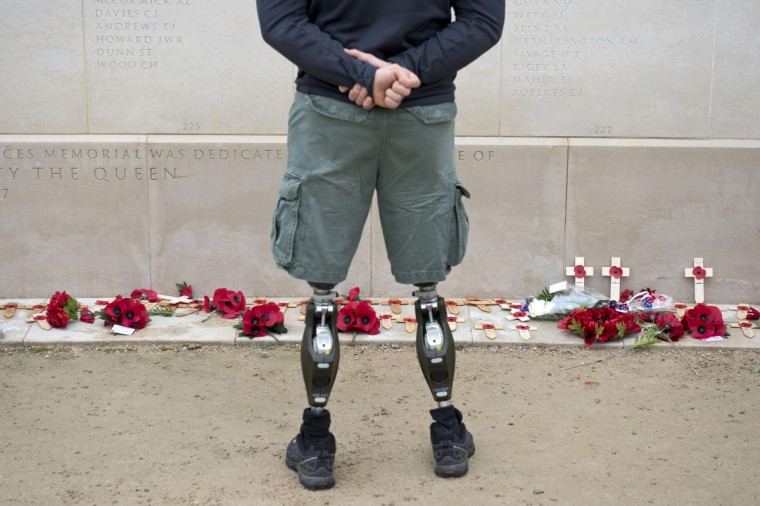 A member of the armed forces with prosthetic legs pays his respects at the Armed Forces Memorial in the National Memorial Arboretum on Armistice Day near Lichfield, Staffordshire, central England, on November 11, 2014. (Oli Scarff/AFP/Getty Images)