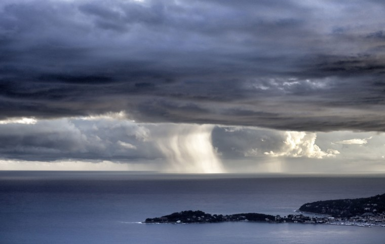 A water spout forms on the horizon on November 15, 2014 off the Mediterranean coastal city of Nice, in southeastern France. Valery Hache/Getty Images)