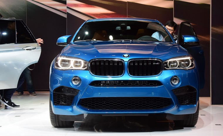 A man steps into the driver's seat of BMW's just-unveiled X6-M on display at the LA Auto Show's press and trade day in Los Angeles, California on November 19, 2014. Nearly 60 North American and World vehicle debuts will be unveiled at this years auto show which opens to the public from November 21 to 30. (Frederic J. Brown/Getty Images)