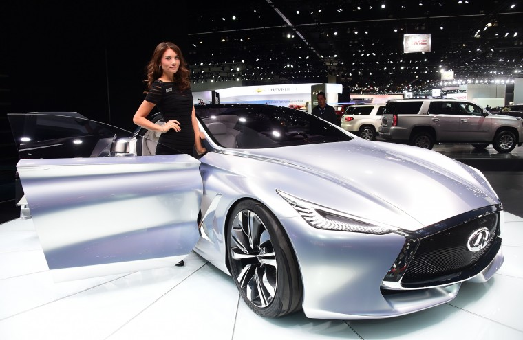 A model poses beside the Infiniti Q80 Inspiration concept vehicle on display at the LA Auto Show's press and trade day in Los Angeles, California on November 20, 2014. The LA Auto Show which opens to the public on November 21 and will run until November 30. (Frederic J. Brown/AFP/Getty Images)