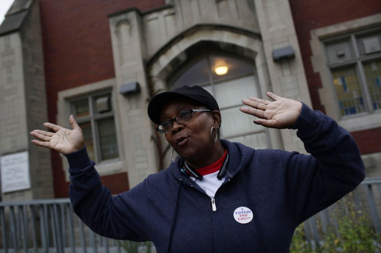 Irma Hudson dances after voting at a polling station during the mid-term elections November 4, 2014 in Detroit, Michigan. Today Americans head to the polls to cast their vote in the mid-term elections leaving the control of the US Senate in question. (Joshua Lott/Getty Images)