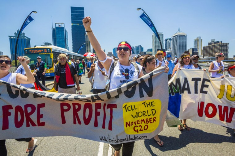 Demonstrators protest in the Brisbane CBD over climate change, uranium mining, coal seam gas fracking and traditional land rights ahead of the 2014 G20 Leaders Summit on November 11, 2014 in Brisbane, Australia. International leaders will descend on Brisbane for the annual G20 summit November 15-16. (Glenn Hunt/Getty Images)