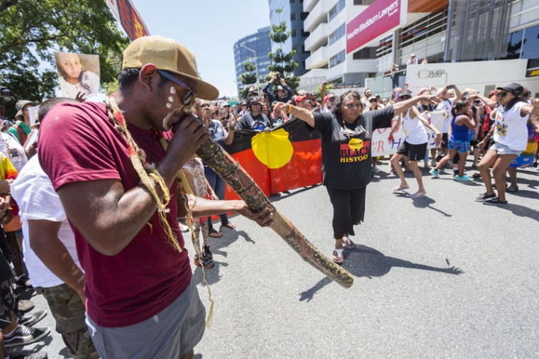 Demonstrators gather to protest the deaths of indigenous Australians while in custody on November 14, 2014 in Brisbane, Australia. World leaders have gathered in Brisbane for the annual G20 Summit and are expected to discuss economic growth, free trade and climate change as well as pressing issues including the situation in Ukraine and the Ebola crisis. (Glenn Hunt/Getty Images)