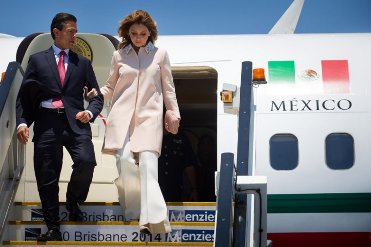 Mexico's President Enrique Pena Nieto and First Lady Angelica Rivera Hurtado arrive at G20 Terminal on November 14, 2014 in Brisbane, Australia. World leaders have gathered in Brisbane for the annual G20 Summit and are expected to discuss economic growth, free trade and climate change as well as pressing issues including the situation in Ukraine and the Ebola crisis. (Patrick Hamilton/G20 Australia via Getty Images)
