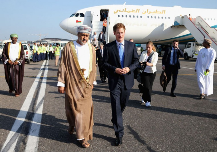 Prince Harry chats to the Sultan of Oman's First Cousin His Highness Sayyid Haithem Bin Tariq Al Said as he arrives at the VIP section of Muscat International Airport on November 18, 2014 in Muscat, Oman. Prince Harry is on a three day visit to Oman before heading to Abu Dhabi to compete in a charity polo match for his charity Sentebale. (Chris Jackson/Getty Images)