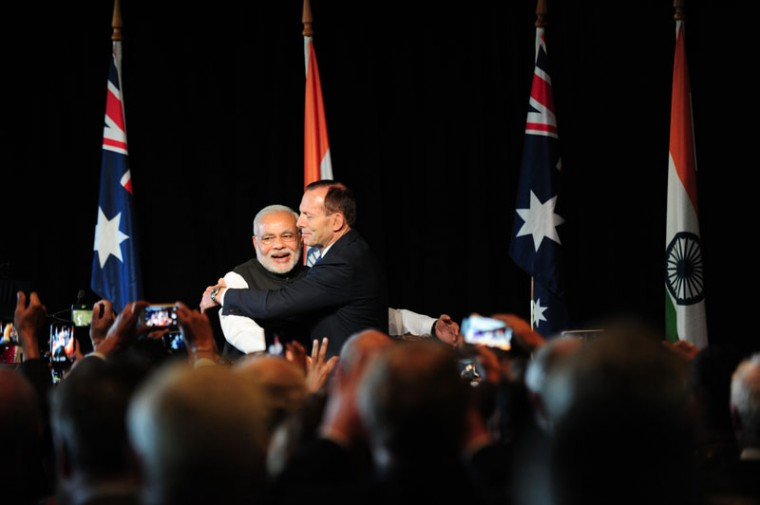 India's prime minister Narendra Modi is hugged by Australian Prime Minister Tony Abbott at a reception held by the Australian prime minister at the Melbourne Cricket Ground On November 18, 2014 in Melbourne, Australia. (Tracey Nearmy - Pool/Getty Images)