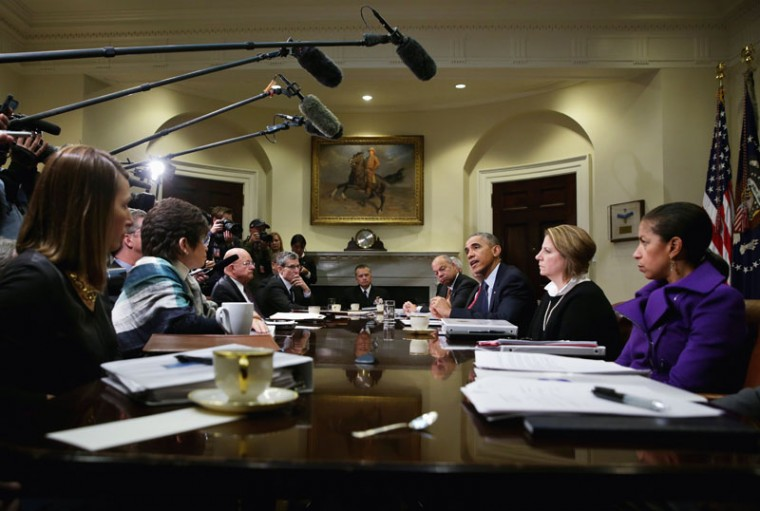 U.S. President Barack Obama (3rd R) speaks as Secretary of Homeland Security Jeh Johnson (4th R), White House Homeland Security Adviser Lisa Monaco (2nd R), National Security Adviser Susan Rice (R), and Director of National Intelligence James Clapper (7th R) listen during a meeting with his national security and public health teams November 18, 2014 at the Roosevelt Room of the White House in Washington, DC. President Obama received update on the Ebola response from his teams during the meeting. (Alex Wong/Getty Images)
