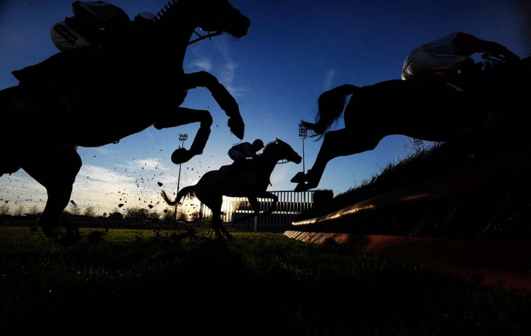 A general view as a runners clear a fence at Kempton Park racecourse on November 24, 2014 in Sunbury, England. (Alan Crowhurst/Getty Images)