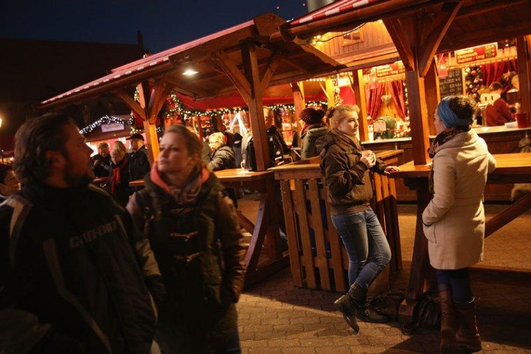 People stroll and drink Gluehwein at the Christmas market at Alexanderplatz on the market's opening day on November 24, 2014 in Berlin, Germany. Christmas markets across Germany will open this week and stay open through the end of December to sell Gluehwein, Christmas decorations, sweets and other delights in an annual tradition. (Sean Gallup/Getty Images)