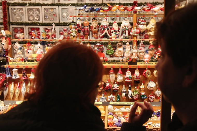 Visitors stop at a stall selling Christmas decorations at the Christmas market at Alexanderplatz on the market's opening day on November 24, 2014 in Berlin, Germany. Christmas markets across Germany will open this week and stay open through the end of December to sell Gluehwein, Christmas decorations, sweets and other delights in an annual tradition. (Sean Gallup/Getty Images)