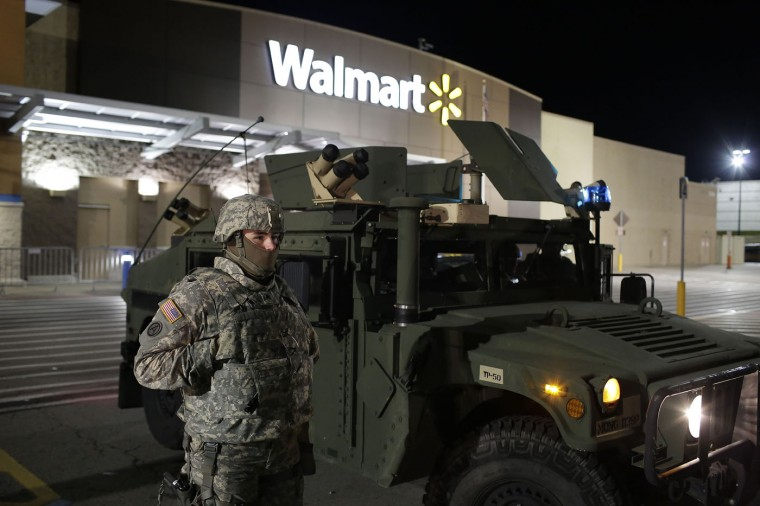 A National Guard troop stands outside of a closed Walmart November 27, 2014 in Ferguson, Missouri. Local businesses still remain closed to consumers in Ferguson as tension continue to still run high the community after Michael Brown, a 18-year-old black male teenager was fatally wounded by Darren Wilson, a white Ferguson Police officer on August 9, 2014. A St. Louis County 12-member grand jury who reviewed evidence related to the shooting decided Monday not to indict Wilson with charges sparking riots through out Ferguson. (Photo by Joshua Lott/Getty Images)