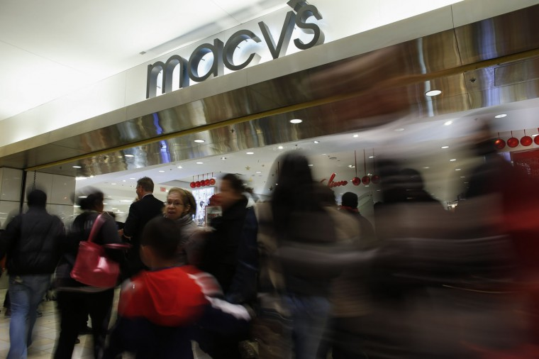People enter to Macy's store at the Newport Mall on November 27, 2014 in Jersey City, New Jersey. Black Friday sales, which now begin on the Thursday of Thanksgiving, continue to draw shoppers out for deals and sales. (Photo by Kena Betancur/Getty Images)