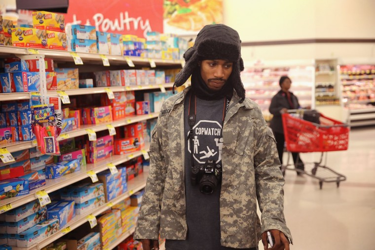 David Whitt shops for groceries for Thanksgiving dinner on Thanksgiving Day November 27, 2014 near Ferguson, Missouri. Whitt lives in the Canfield Green Apartments near where Michael Brown was killed. The Ferguson area has been struggling to return to normal since the August 9 shooting of Brown, an 18-year-old black man, who was killed by Darren Wilson, a white Ferguson police officer. Monday, when the grand jury announced that Wilson would not face charges in the shooting, rioting and looting broke out throughout the area. (Photo by Scott Olson/Getty Images)
