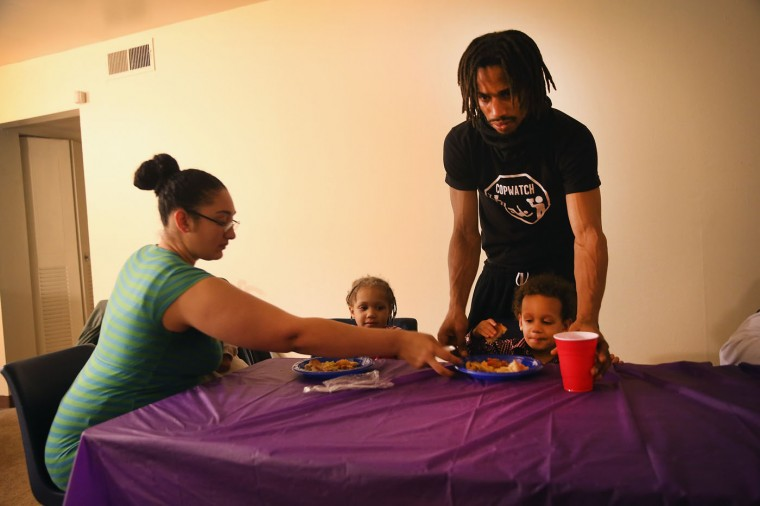 Aurellia Davis (L) and her husband David Whitt have Thanksgiving dinner with their children at the Canfield Green Apartments where Michael Brown was killed on November 27, 2014 in Ferguson, Missouri. The Ferguson area has been struggling to return to normal since the August 9 shooting of Brown, an 18-year-old black man, who was killed by Darren Wilson, a white Ferguson police officer. Monday, when the grand jury announced that Wilson would not face charges in the shooting, rioting and looting broke out throughout the area. (Photo by Scott Olson/Getty Images)