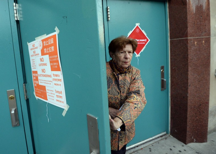 A woman leaves after casting her vote at a polling station in New York on November 4, 2014. Americans began voting on November 4, in key legislative elections expected to deal a stinging defeat to President Barack Obama, with Republicans poised to take full control of Congress by wresting the Senate from his Democrats. The party of an incumbent US president historically fares badly in elections in the middle of his second term, and this time is expected to be no different for Obama. (/Jewel Samad/AFP/Getty Images)