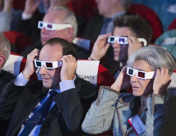 French President Francois Hollande (L) and former French astronaut and minister Claudie Haignere wear 3D glasses to view the first results of the Rosetta mission on the 67P/Churyumov-Gerasimenko comet at the Cite des Sciences in Paris on November 12, 2014. A European probe made the first-ever landing on a comet in a quest to explore the origins of the Solar System, but there were concerns over whether it was fastened securely enough to carry out its mission. (Jacques Brinon/AFP/Getty Images)