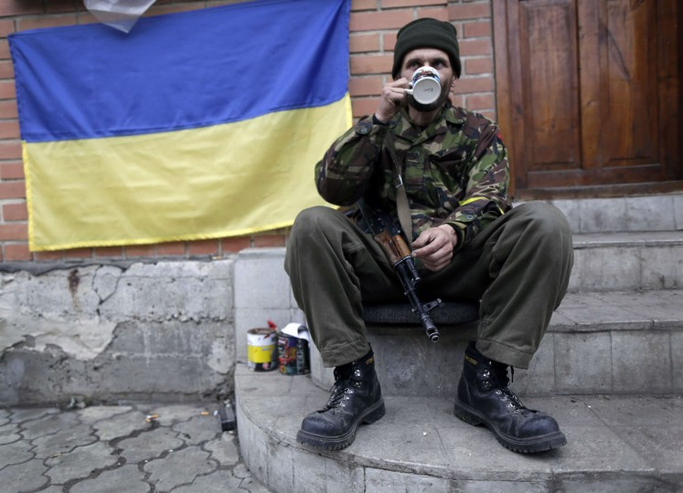 "A Ukrainian ""Right Sector"" volunteer takes a rest at his position near the village of Peski, next to Donetsk's airport on November 13, 2014. The International pressure on Russia was mounting on November 13 over claims it is sending fresh military hardware into eastern Ukraine which could fuel a return to all-out conflict. (Max Vetrov/AFP/Getty Images)"
