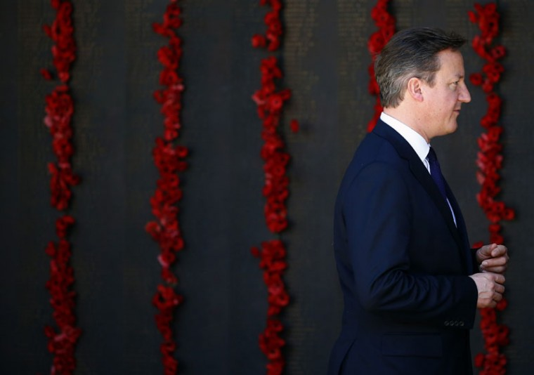 Britain's Prime Minister David Cameron stands in front of the Roll of Honor during a visit to the Australian War Memorial in Canberra on November 14, 2014. Cameron is in Australia to attend the G20 Summit in Brisbane on November 15-16. (David Gray/AFP/Getty Images)