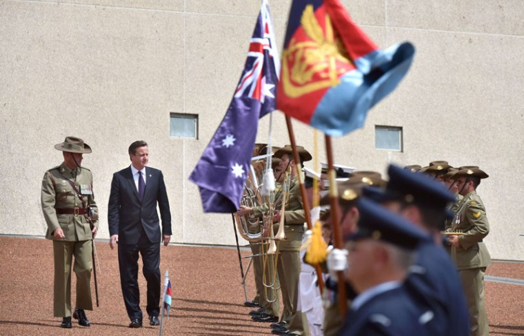Britain's Prime Minister David Cameron (2nd L) inspects the Federation Guard during a ceremonial welcome at Parliament House in Canberra on November 14, 2014. Cameron is in Australia to attend the G20 Summit in Brisbane on November 15-16. (Mark Graham/AFP/Getty Images)