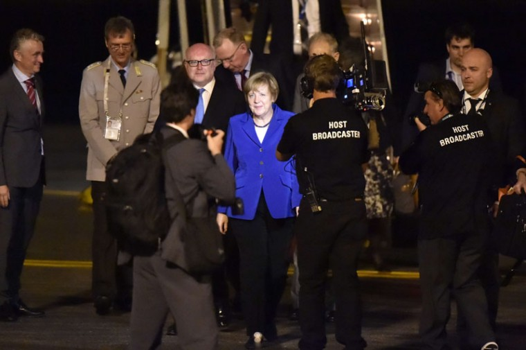 Germany's Chancellor Angela Merkel (C) is welcomed upon her arrival at the airport in Brisbane to take part in the G20 summit on November 14, 2014. Australia hosts the leaders of the world's 20 biggest economies for the G20 summit in Brisbane on November 15 and 16. (Peter Parks/AFP/Getty Images)