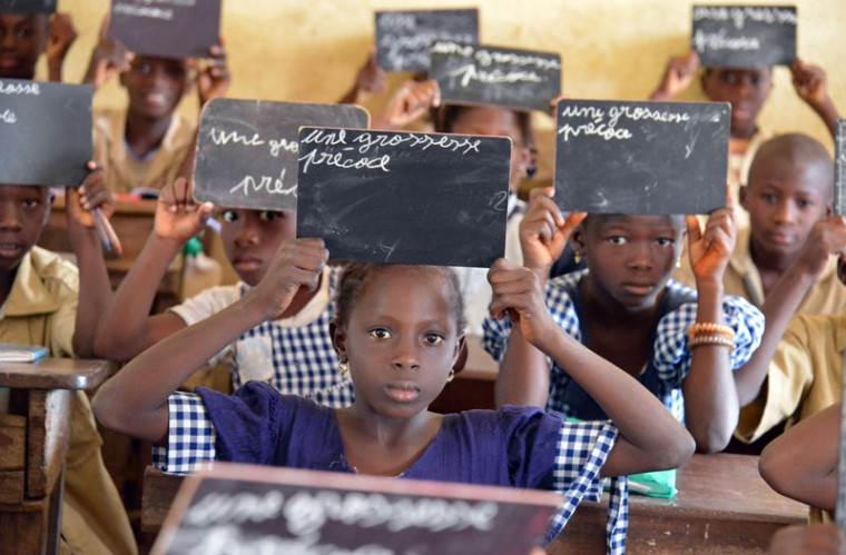 Schoolchildren hold black boards at a primary school in Bouake, central Ivory Coast. (Issouf Sanogo/AFP/Getty Images)