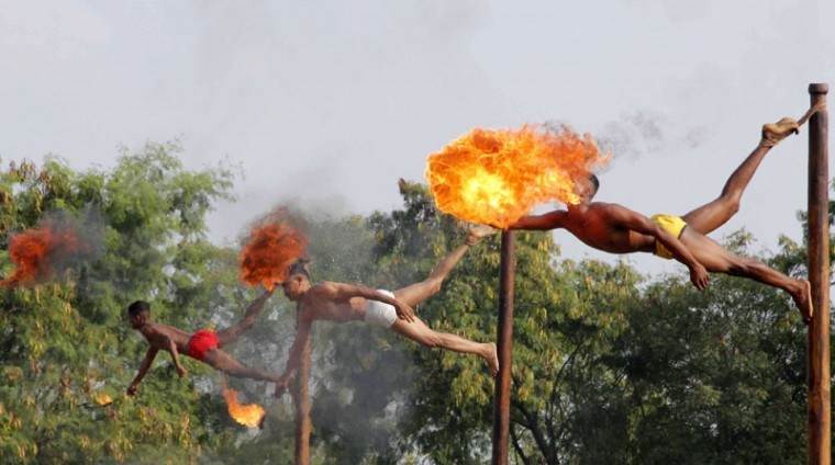 Indian soldiers take part in a demonstration of 'fire breathing' at the start of Operation Hand in Hand - a joint training exercise between Indian and Chinese troops - at Aundh Military Camp in Pune on November 18, 2014. The ten day exercise with the Asian neighbors in the western Indian state of Maharashtra is set to focus on sharing strategic knowhow in counter-insurgency and counter-terrorism operations. (Strstrdel/AFP/Getty Images)