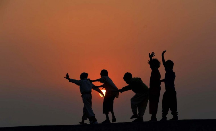 Pakistani children play on the roof of a house on the outskirts of Lahore on November 19, 2014. The United Nations' Universal Children's Day is celebrated annually on November 20 to promote worldwide fraternity and understanding between children.(Arif Ali/AFP/Getty Images)