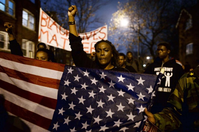 Demonstrators shout slogans during a march in St. Louis, Missouri, on November 23, 2014 to protest the death of 18-year-old Michael Brown. More than 100 protesters marched peacefully through St Louis on November 23, stepping up pressure on a grand jury to indict a white police officer for shooting dead an unarmed black teenager. Police stepped up security and erected barricades bracing for the worst with a grand jury to decide whether to indict the police officer. Brown was shot at least six times by police officer Darren Wilson in the St. Louis suburb of Ferguson on August 9, inflaming racial tensions and sparking weeks of protests, some violent. (Jewel Samad/AFP/Getty Images)