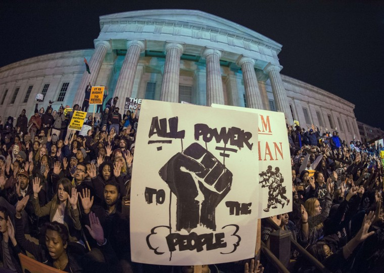 Protestors demonstrate on the steps of the National Portrait Gallery November 25, 2014 in Washington, DC, one day after a grand jury decision not to prosecute a white police officer for the killing of an unarmed black teen in Ferguson, Missouri. Paul J. Richards/AFP/Getty Images