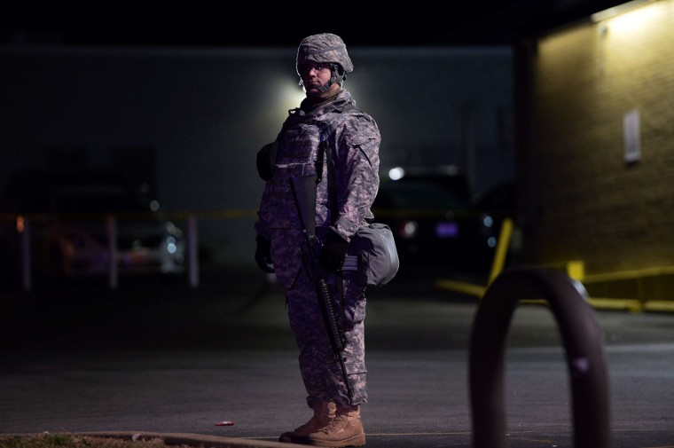 A National Guard trooper keeps vigil around local business in Ferguson, Missouri, on November 25, 2014 during demonstrations a day after violent protests and looting following the grand jury decision in the fatal shooting of a 18-year-old black teenager Michael Brown. Missouri Governor Jay Nixon told reporters that a total of 2,200 National Guard troops were being deployed in the St Louis area on November 25-- triple the 700 sent out the night before. Looting erupted and businesses were set ablaze in the St Louis suburb overnight Monday, after a grand jury opted not to indict white police officer Darren Wilson for the fatal shooting of unarmed black teenager Michael Brown in August. Jewel SamadJ/AFP/Getty Images
